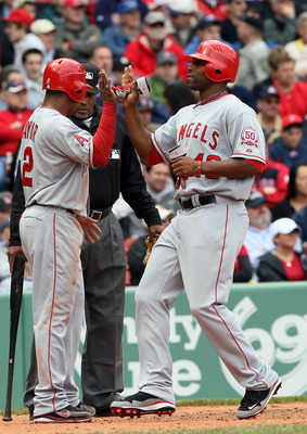BOSTON, MA - MAY 05:  Erick Aybar #2 of the Los Angeles Angels cekebrates with teammate Torii Hunter #48 after they both scored in the third inning against the Boston Red Sox on May 5, 2011 at Fenway Park in Boston, Massachusetts.  (Photo by Elsa/Getty Im