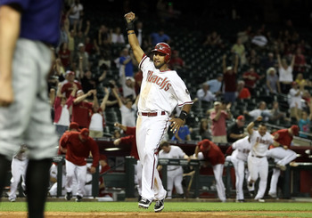PHOENIX, AZ - MAY 05:  Chris Young #24 of the Arizona Diamondbacks celebrates as he scores the game winning run against the Colorado Rockies in 11th inning of the Major League Baseball game at Chase Field on May 5, 2011 in Phoenix, Arizona.  The Diamondba