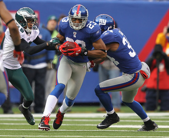 EAST RUTHERFORD, NJ - DECEMBER 19:  Corey Webster #23 of the New York Giants intercepts the ball during their game against the Philadelphia Eagles on December 19, 2010 at The New Meadowlands Stadium in East Rutherford, New Jersey.  (Photo by Al Bello/Gett