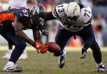 DENVER, CO - JANUARY 2:  Linebacker Mario Haggan #57 of the Denver Broncos and offensive tackle Marcus McNeill #73 of the San Diego Chargers battle for the ball following a fumble by runningback Ryan Mathews #24 of the San Diego Chargers during the second