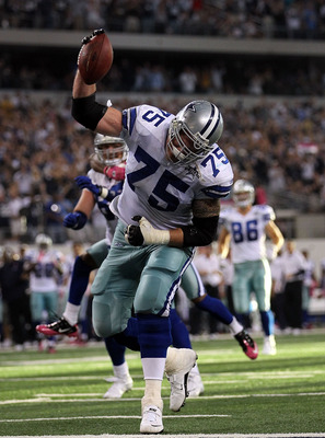 ARLINGTON, TX - OCTOBER 10:  Marc Colombo #75 of the Dallas Cowboys spikes the ball after a touchdown by Jason Witten against the Tennessee Titans at Cowboys Stadium on October 10, 2010 in Arlington, Texas.  (Photo by Ronald Martinez/Getty Images)
