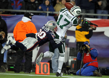 FOXBORO, MA - JANUARY 16:  Braylon Edwards #17 of the New York Jets falls out of bounds as he catches a pass over Darius Butler #28 of the New England Patriots during their 2011 AFC divisional playoff game at Gillette Stadium on January 16, 2011 in Foxbor