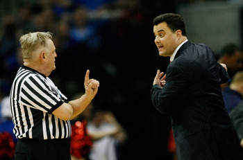 TULSA, OK - MARCH 20:  Head coach Sean Miller of the Arizona Wildcats argues with referee Jim Burr during the third round against the Texas Longhorns in the 2011 NCAA men's basketball tournament at BOK Center on March 20, 2011 in Tulsa, Oklahoma.  (Photo