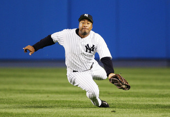 NEW YORK - MAY 29:  Center fielder Bernie Williams #51 of the New York Yankees makes a diving catch on a hit by Johnny Damon #18 of the Boston Red Sox in the fourth inning of the game at Yankee Stadium on May 29, 2005 in the Bronx borough of New York City