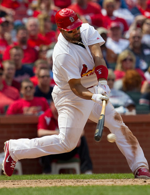 ST. LOUIS, MO - MAY 5: Albert Pujols #5 of the St. Louis Cardinals hits a single against the Florida Marlins at Busch Stadium on May 5, 2011 in St. Louis, Missouri.  (Photo by Dilip Vishwanat/Getty Images)