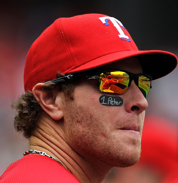 ARLINGTON, TX - APRIL 24:  Josh Hamilton #32 of the Texas Rangers watches from the dugout against the Kansas City Royals at Rangers Ballpark in Arlington on April 24, 2011 in Arlington, Texas.  (Photo by Ronald Martinez/Getty Images)