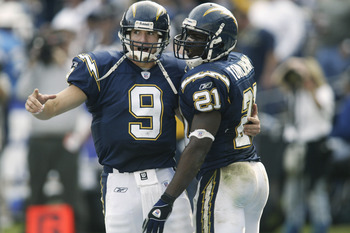 SAN DIEGO - DECEMBER 1:  Drew Brees #9 of the San Diego Chargers congratulates LaDainian Tomlinson #21 after Tomlinson's third touchdown of the first half of the  game versus the Denver Broncos on December 1, 2002 at Qualcomm Stadium in San Diego, Califor