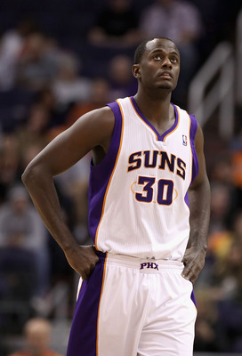 PHOENIX - DECEMBER 10:  Earl Barron #30 of the Phoenix Suns during the NBA game against the Portland Trail Blazers at US Airways Center on December 10, 2010 in Phoenix, Arizona. The Trail Blazers defeated the Suns 101-94.  NOTE TO USER: User expressly ack