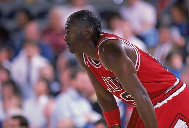 1988: Michael Jordan #23 of the Chicago Bulls rests on the court during a game. NOTE TO USER: User expressly acknowledges and agrees that, by downloading and/or using this Photograph, User is consenting to the terms and conditions of the Getty Images Lice