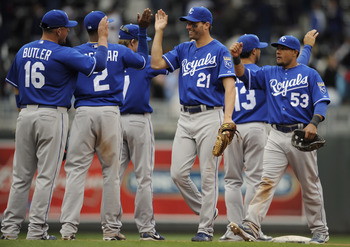 MINNEAPOLIS, MN - APRIL 13: Jeff Francoeur #21 and Melky Cabrera #53 of the Kansas City Royals celebrate a 10-5 win against the Minnesota Twins following their game on April 13, 2011 at Target Field in Minneapolis, Minnesota. Royals defeated the Twins 10-