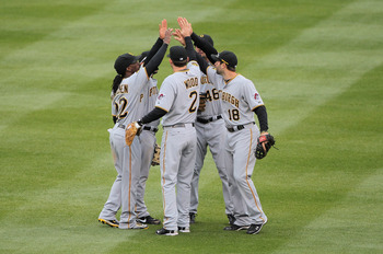 DENVER, CO - MAY 01:  Xavier Paul #38, Andrew McCutchen #22, Brandon Wood #2, Garrett Jones #46, and Neil Walker #18 of the Pittsburgh Pirates celebrate their victory over the Colorado Rockies at Coors Field on May 1, 2011 in Denver, Colorado. The Pirates