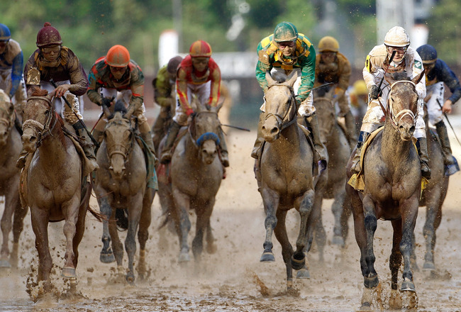 LOUISVILLE, KY - MAY 01:  Calvin Borel atop Super Saver crosses the finish line to win the 136th running of the Kentucky Derby on May 1, 2010 in Louisville, Kentucky.  (Photo by Matthew Stockman/Getty Images)