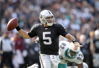 OAKLAND, CA - NOVEMBER 28:  Bruce Gradkowski #5 of the Oakland Raiders passes the ball against the Miami Dolphins at Oakland-Alameda County Coliseum on November 28, 2010 in Oakland, California.  (Photo by Ezra Shaw/Getty Images)