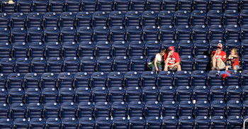 WASHINGTON, DC - APRIL 17:  Fans watch from the upper deck during a game between the Washington Nationals and the Milwaukee Brewers during the second game of a doubleheader at Nationals Park on April 17, 2011 in Washington, DC.  (Photo by Rob Carr/Getty I