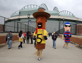 MILWAUKEE, WI - APRIL 04: Members of the 'racing sausages' walk out to greet fans before the home opener between the Atlanta Braves and the Milwaukee Brewers at Miller Park on April 4, 2011 in Milwaukee, Wisconsin. (Photo by Jonathan Daniel/Getty Images)