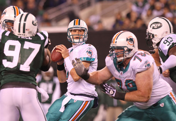 EAST RUTHERFORD, NJ - DECEMBER 12:  Chad Henne #7 of the Miami Dolphins drops back to pass against the New York Jets at New Meadowlands Stadium on December 12, 2010 in East Rutherford, New Jersey.  (Photo by Nick Laham/Getty Images)