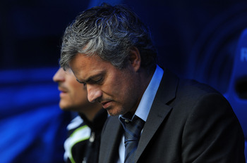 MADRID, SPAIN - APRIL 30: Head coach of Real Madrid Jose Mourinho looks down before the start of  the La Liga match between Real Madrid and Real Zaragona at Estadio Santiago Bernabeu on April 30, 2011 in Madrid, Spain.  (Photo by Denis Doyle/Getty Images)
