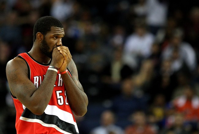 OAKLAND, CA - NOVEMBER 20:  Greg Oden #52 of the Portland Trail Blazers looks on against the Golden State Warriors during an NBA game at Oracle Arena on November 20, 2009 in Oakland, California.  (Photo by Jed Jacobsohn/Getty Images)