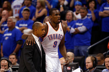 OKLAHOMA CITY, OK - MAY 03:  Guard Serge Ibaka #9 of the Oklahoma City Thunder is helped off the court after falling against the Memphis Grizzlies in Game Two of the Western Conference Semifinals in the 2011 NBA Playoffs on May 3, 2011 at Oklahoma City Ar