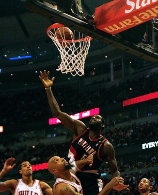 CHICAGO - JANUARY 12: Greg Oden #52 of the Portland Trail Blazers hits a shot under pressure from (L-R) Thabo Sefolosha #2, Drew Gooden #90 and Derrick Rose #1 of the Chicago Bulls on January 12, 2009 at the United Center in Chicago, Illinois. NOTE TO USE