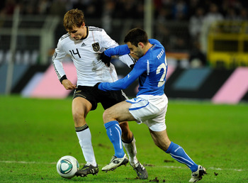 DORTMUND, GERMANY - FEBRUARY 09:  Giuseppe Rossi of Italy and Holger Badstuber of Germany compete for the ball during the International Friendly match between Germany and Italy on February 9, 2011 in Dortmund, Germany.  (Photo by Claudio Villa/Getty Image
