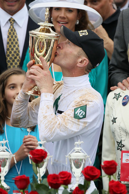 LOUISVILLE, KY - MAY 01:  Jockey Calvin Borel kisses the 136th Kentucky Derby trophy in the winners circle after his win atop Super Saver on May 1, 2010 in Louisville, Kentucky.  (Photo by Andy Lyons/Getty Images)