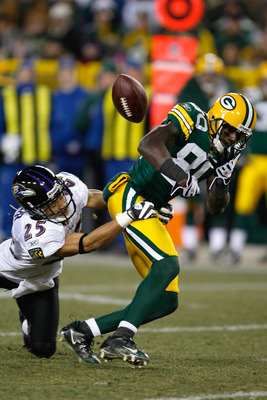Chris Carr causes Donald Driver to lose the ball