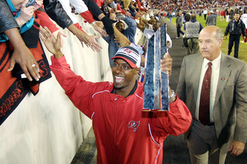 TAMPA, FL - JANUARY 27:  Tampa Bay Buccaneer Dexter Jackson high-fives fans while holding his Super Bowl MVP trophy during a Superbowl victory celebration January 27, 2003 at Raymond James Stadium in Tampa, Florida. The Buccaneers defeated the Oakland Rai