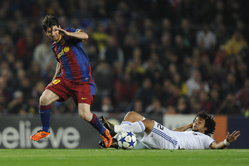 BARCELONA, SPAIN - MAY 03:  Lionel Messi of FC Barcelona (L) fights for the ball against Marcelo Real Madrid during the UEFA Champions League Semi Final second leg match between Barcelona and Real Madrid at the Camp Nou on May 3, 2011 in Barcelona, Spain.