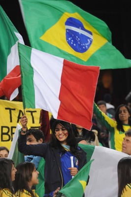 PRETORIA, SOUTH AFRICA - JUNE 21:  Italian and Brazilian fans wave flags during the FIFA Confederations Cup match between Italy and Brazil at the Loftus Versfeld Stadium on June 21, 2009 in Pretoria, South Africa.  (Photo by Lee Warren/Gallo Images/Getty