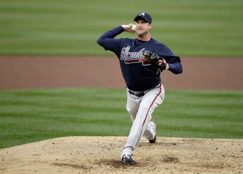 WASHINGTON, DC - MARCH 31:  Starting pitcher Derek Lowe #32 of the Atlanta Braves pitches against the Washington Nationals at Nationals Park on March 31, 2011 in Washington, DC.  (Photo by Rob Carr/Getty Images)