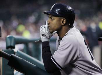 DETROIT, MI - MAY 03:  Curtis Granderson #14 of the New York Yankees looks on from the dugout while playing the Detroit Tigers at Comerica Park on May 3, 2011 in Detroit, Michigan. Detroit won the game 4-2. (Photo by Gregory Shamus/Getty Images)