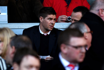 LIVERPOOL, ENGLAND - FEBRUARY 12:  Steven Gerrard of Liverpool looks on from the stands prior to the Barclays Premier League match between Liverpool and Wigan Athletic at Anfield on February 12, 2011 in Liverpool, England.  (Photo by Clive Brunskill/Getty