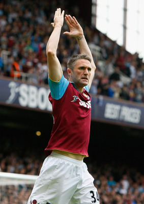 LONDON, ENGLAND - APRIL 16:  Robbie Keane of West Ham United celebrates scoring the opening goal during the Barclays Premier League match between West Ham United and Aston Villa at the Boleyn Ground on April 16, 2011 in London, England.  (Photo by Tom Dul
