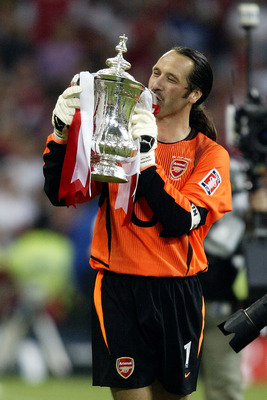 CARDIFF - MAY 17:  David Seaman of Arsenal kisses the FA Cup after winning the FA Cup Final match between Arsenal and Southampton on May 17, 2003 at the Millennium Stadium in Cardiff, Wales.  Arsenal won the match and the FA cup 1-0.  (Photo by Clive Maso