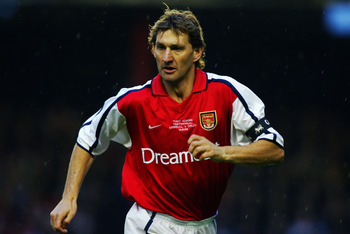 LONDON - MAY 13:  Tony Adams of Arsenal in action during The Tony Adams Testimonial match between Arsenal and Celtic played at Highbury, in London on May 13, 2002. The match ended in a 1-1 draw. DIGITAL IMAGE. (Photo by Ben Radford/Getty Images)