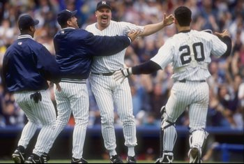 17 May 1998: David Wells #33 of the New York Yankees celebrates his perfect game against the Minnesota Twins with teammates Jorge Posada #20 and Luis Sojo #19 at Yankee Stadium in the Bronx, New York. The Yankees defeated the Twins 4-0.
