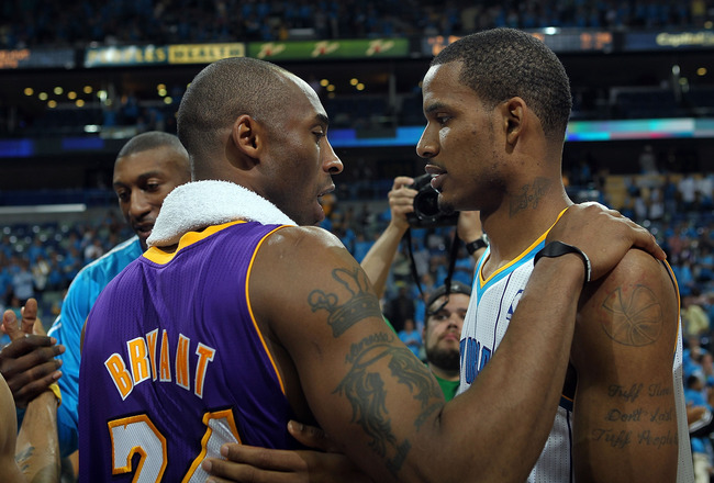 NEW ORLEANS, LA - APRIL 28:  Trevor Ariza #1 of the New Orleans Hornets hugs Kobe Bryant #24 of the Los Angeles Lakers after the Lakers won the series in Game Six of the Western Conference Quarterfinals in the 2011 NBA Playoffs on April 28, 2011 at New Or