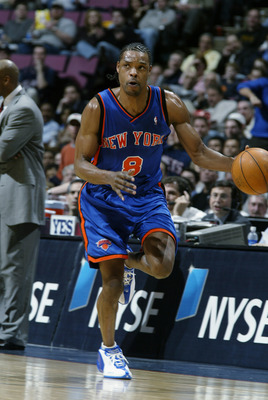 EAST RUTHERFORD, NJ - MARCH 26:  Latrell Sprewell #8 of the New York Knicks brings the bal upcourt during the NBA game against the New Jersey Nets at Continental Airlines Arena on March 26, 2003 in East Rutherford, New Jersey.  The Nets won 101-95.  NOTE