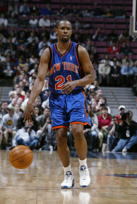 EAST RUTHERFORD, NJ - MARCH 26:  Charlie Ward #21 of the New York Knicks brings the ball forward during the NBA game against the New Jersey Nets at Continental Airlines Arena on March 26, 2003 in East Rutherford, New Jersey.  The Nets won 101-95.  NOTE TO