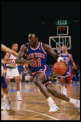 1990-1991:  Guard Gerald Wilkins of the New York Knicks in action during a game against the Denver Nuggets at the McNichols Arena in Denver, Colorado. Mandatory Credit: Tim de Frisco  /Allsport