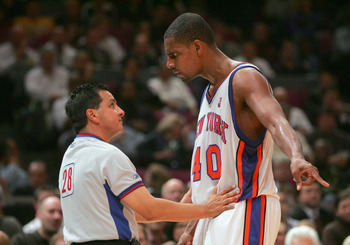 NEW YORK - NOVEMBER 23:  Kurt Thomas #40 of the New York Knicks speaks with referee Tom Nunez #28 while playing against the Atlanta Hawks on November 23, 2004 at Madison Square Garden in New York City.  The Knicks defeated the Hawks 104-88.  NOTE TO USER: