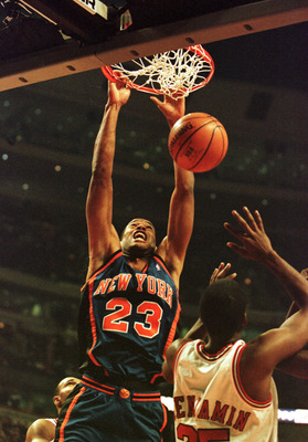 01 Dec 2000: Center Marcus Camby #23 of the New York Knicks slams the ball down while Guard Cory Benjamin #25 of the Chicago Bulls attempts to defend in early action at the United Center in Chicago, Illinois. Mandatory Credit: Jonathan Daniel/ALLSPORT  NO