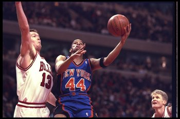 14 May 1996:  Hubert Davis of the New York Knicks goes up for two against center Luc Longley of the Chicago Bulls during a game played at the United Center in Chicago, Illinois.  The Bulls won the game, 94-81. Mandatory Credit: Doug Pensinger/Allsport