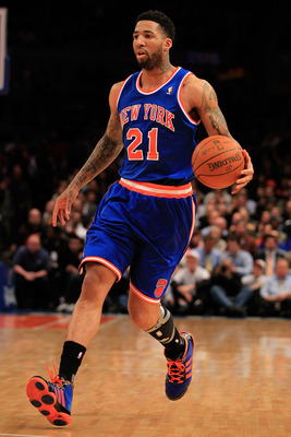 NEW YORK, NY - FEBRUARY 16:  Wilson Chandler #21 of the New York Knicks dribbles the ball against the Atlanta Hawks at Madison Square Garden on February 16, 2011 in New York City. NOTE TO USER: User expressly acknowledges and agrees that, by downloading a