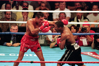 LOS ANGELES - JUNE 17:  Sugar Shane Mosley throws a punch to Oscar De La Hoya during the World WelterWeight Fight at Staples Center on June 17, 2000 in Los Angeles, California. Sugar Shane Mosley won by decision in the 12 round. ( Photo by: Jed Jacobsohn/