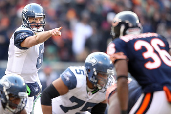 CHICAGO, IL - JANUARY 16:  Quarterback Matt Hasselbeck #8 of the Seattle Seahawks points from under center against the Chicago Bears in the 2011 NFC divisional playoff game at Soldier Field on January 16, 2011 in Chicago, Illinois.  (Photo by Andy Lyons/G