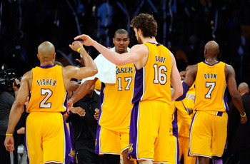 LOS ANGELES, CA - APRIL 20:  (R-L) Derek Fisher #2, Andrew Bynum #17 and Pau Gasol #16 of the Los Angeles Lakers celebrate while taking on the New Orleans Hornets in Game Two of the Western Conference Quarterfinals in the 2011 NBA Playoffs on April 20, 20