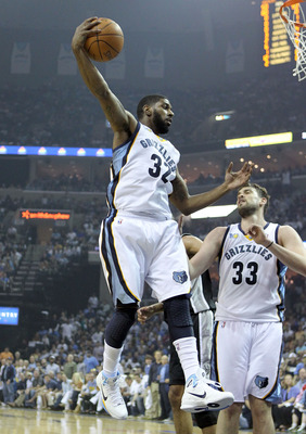 MEMPHIS, TN - APRIL 23:  O.J. Mayo #32 of the  Memphis Grizzles grabs a rebound during the game against the San Antonio Spurs in Game three of the Western Conference Quarterfinals in the 2011 NBA Playoffs at FedExForum on April 23, 2011 in Memphis, Tennes