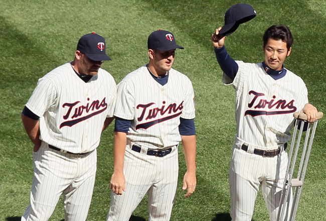 MINNEAPOLIS, MN - APRIL 08:  Tsuyoshi Nishioka #1 of the Minnesota Twins salutes the cheering fans during introductions before Opening Day against the Oakland Athletics  on April 8, 2011 at Target Field in Minneapolis, Minnesota.  (Photo by Elsa/Getty Ima